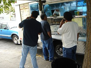 The lure of free tacos brought 'em out to El Tonayense yesterday. - DE LA PAZ COFFEE CO./FLICKR