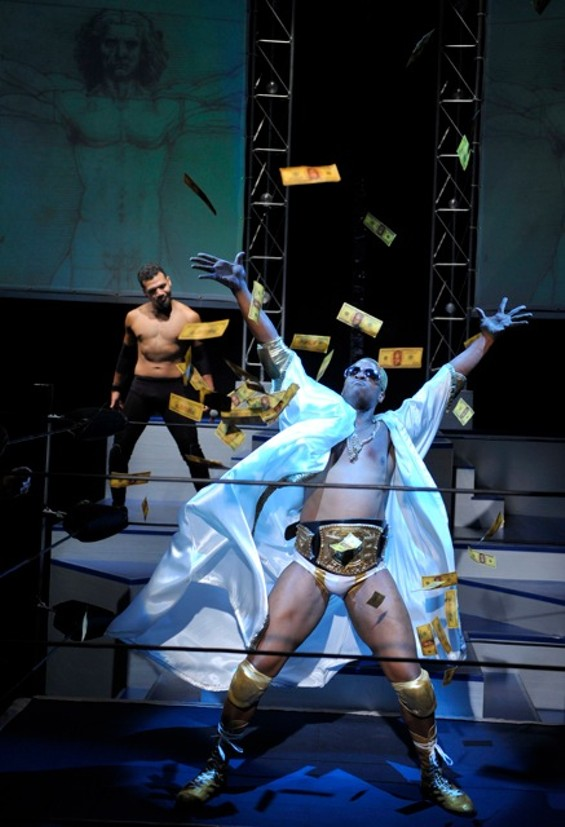 The Mace (back, Tony Sancho) watches the elaborate entrance of fellow wrestler Chad Deity (Beethovan Oden) in the Bay Area premiere of The Elaborate Entrance of Chad Deity - DAVID ALLEN