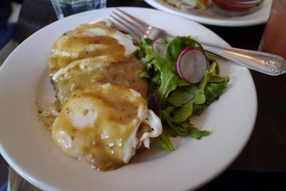 The Madame Rarebit: an open-faced sandwich with fried eggs and cheddar-ale sauce