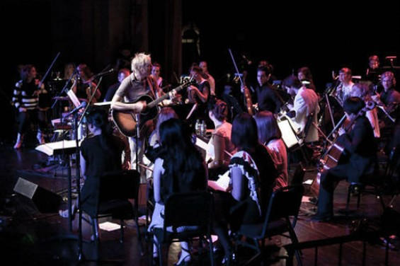 The Magik*Magik Orchestra performing with John Vanderslice. - MOSES NAMKUNG