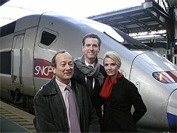 The mayor, his wife, and some French guy in Paris, before Newsom went to Davos.