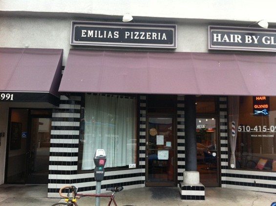 The no-frills exterior of Emilia's Pizza. - MOLLY GORE