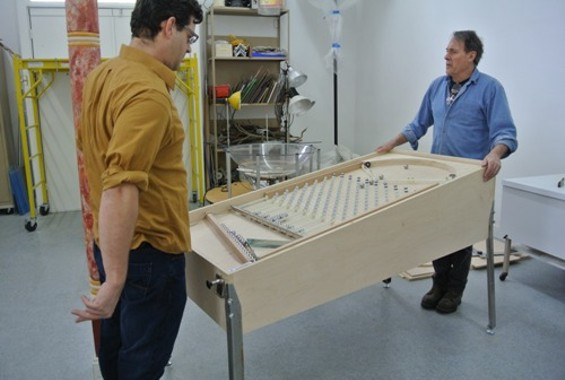 The recently completed, handmade Galton Board Pinball machine gets a test run in the Pacific Pinball Museum's workshop.