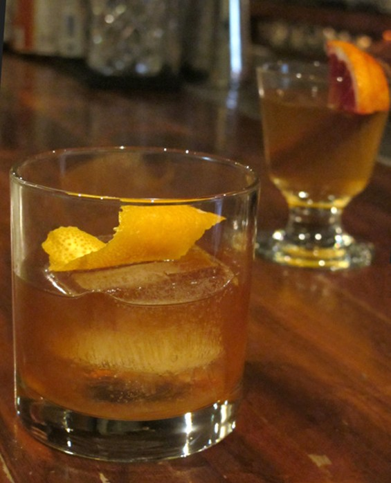 The Rock & Rye Old Fashioned with the Rock & Rye Hot Toddy in back - LOU BUSTAMANTE