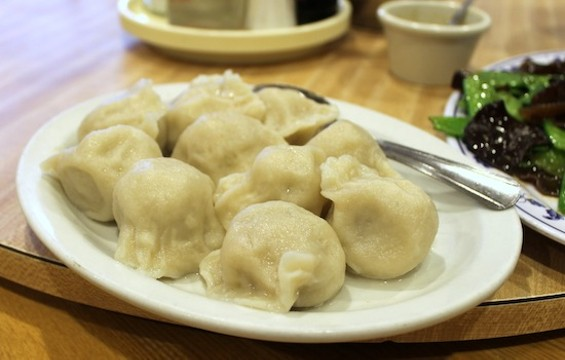 The Shan Dong special dumplings are filled with pork, cabbage, and scallions. - KATE WILLIAMS
