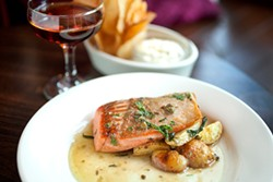 LARA HATA - The silver salmon is seared and covered with a lemon beurre blanc.