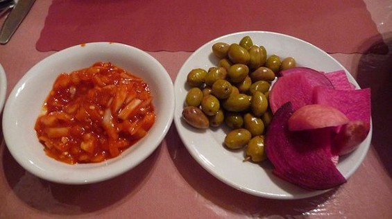 The smuggle-worthy Turkish salad (left). - FALLOPIAN SWIM TEAM D./YELP