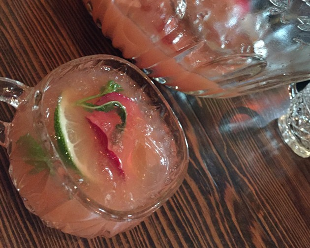 """The """"Strawberry Blonde"""" from the punch bowl section of  Tigerlily's cocktail menu is not to be missed. - ALIX WALL"""