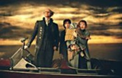 FRANÇOIS  DUHAMEL - The Trouble Begins: Count Olaf (Jim - Carrey) and the Baudelaire children.