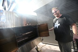 MIKE KOOZMIN - The Whole Beast's John Fink shows off his new smoker at The Hall.