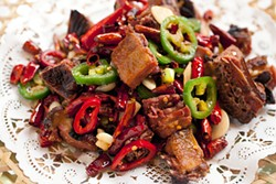 LARA HATA - There are peppers aplenty in the spicy tea-smoked duck.