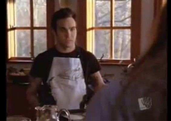 There's Pete Wentz, behind the stove.