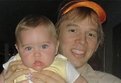 They don't look alike, because this is NOT his child!