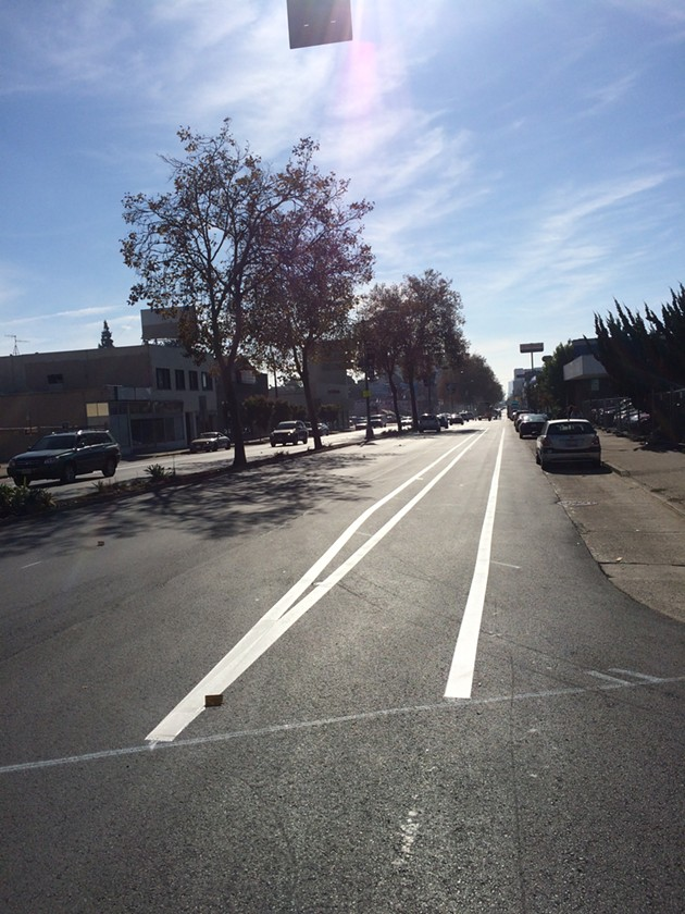 This brand new bike lane on Broadway in Oakland is an example of what you can expect in everyone's future thanks to these ballot measures.