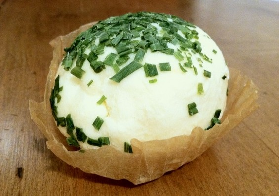 This cheese ball comes with multiple cheeses, sour cream, and chives. - JONATHAN KAUFFMAN