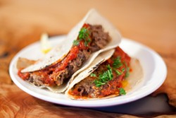 LARA HATA - This taco filling is real meaty: Veal, beef, lamb, and pork belly.