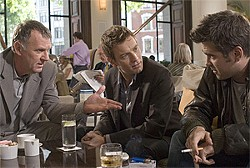 Three men discuss a murder.