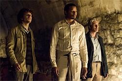 "KAREN BALLARD - Three newsmen (Jesse Eisenberg, Terrence Howard, and Richard Gere) reunite in Bosnia to look for ""The Fox."""