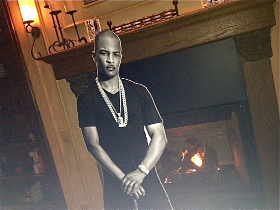T.I. chills by the fire at Studio Trilogy. - TAMARA PALMER