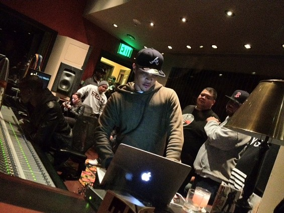 T.I. plays his album Trouble Man at Studio Trilogy in San Francisco. - TAMARA PALMER