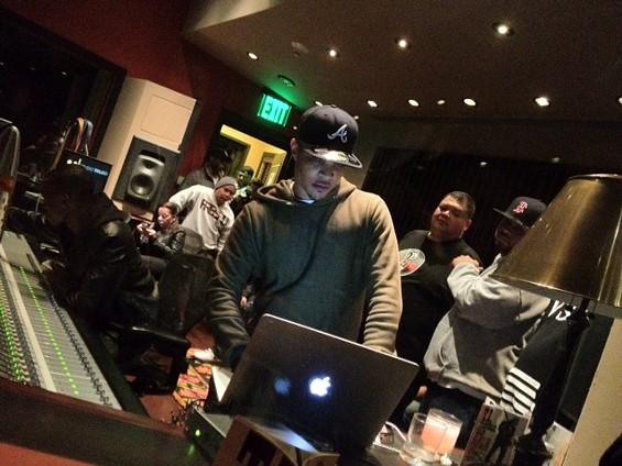 T.I. plays his album Trouble Man at Studio Trilogy in San Francisco. - TAMARA PALMER