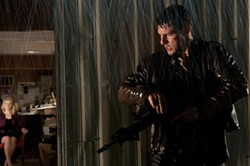 Tom Cruise is fed up with waiting in the rain in Jack Reacher.