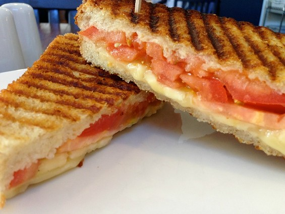 Tomato, cheese, and bananas, all living harmoniously in one sandwich