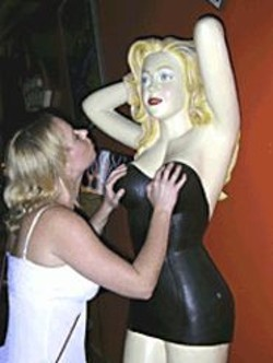 RODRIGO  ENRIQUEZ - Tourgoer Corinne Turton molests a - defenseless female mannequin at the - Power Exchange.