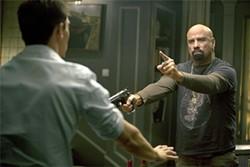 Travolta in all his compellingly horrible jivey splendor.