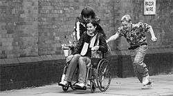 Two rudderless adolescents (Piotr Jagiello, Thomas Turgoose) chauffeur their French waitress crush (Elisa Lasowski) home in a repurposed wheelchair.
