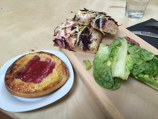 A rhubarb tart and a focaccia pizza with side salad. - PETER LAWRENCE KANE