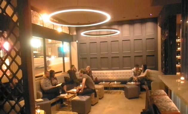 Patrons enjoying drinks at Resolute. - ERIC S. BURKETT