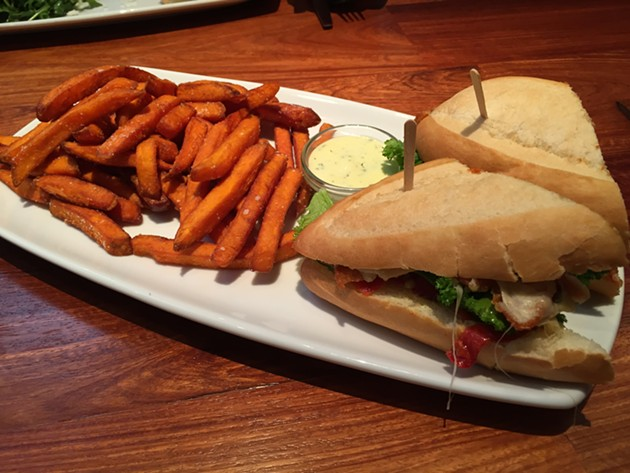 Fried chicken sandwich with sweet potato fries - PETER LAWRENCE KANE