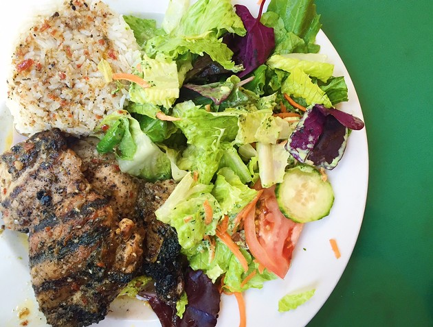 Jerk chicken plate, with rice and a green salad with cilantro dressing. - BETTY WANG