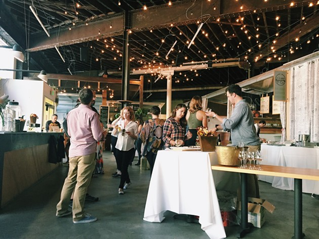 Guests wandering around, sampling all the tasty offerings alongside sipping the hand-selected beers. - BETTY WANG