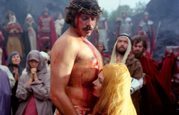 Father Grandier (Oliver Reed) and Sister Jeanne (Vanessa Redgrave) in one of the Sister's bizarre and disturbing fantasies. - WARNER BROTHERS