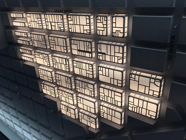 Ceiling lights depict the neighborhood's blocks. - PETER LAWRENCE KANE