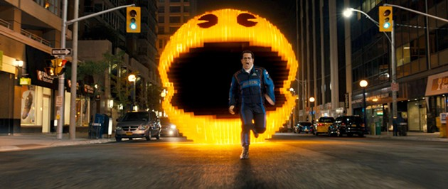 Ac-Man chases Ludlow (Josh Gad) in Columbia Pictures' Pixels. - SONY PICTURES ENTERTAINMENT INC.