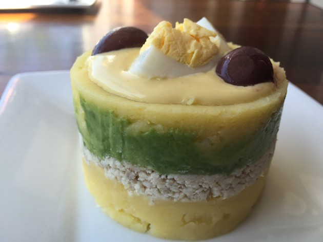 Layers of whipped potato, avocado and chicken make for a colorful appetizer at Oakland's Mistura. - ALIX WALL