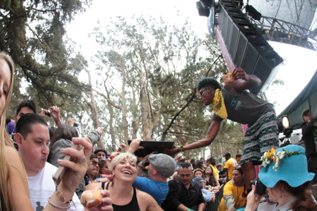 Big Freedia's crew feeding beignets to the GastroMagic crowd. - CHRISTOPHER VICTORIO