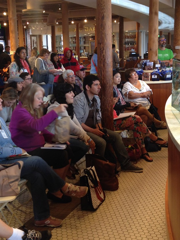 Onlookers watch a chocolatier in Ghirardelli Marketplace - A.K. CARROLL