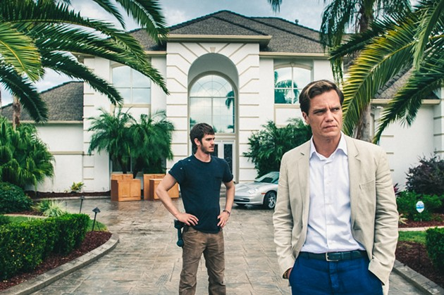 99 Homes, starring [left to right] Andrew Garfield and Michael Shannon, opens Oct. 2. - COURTESY OF BROAD GREEN PICTURES