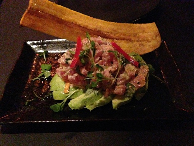 Ahi tartare on aioli sauce with latin peppers, red onion, sea salt, lime and avocado - A.K CARROLL