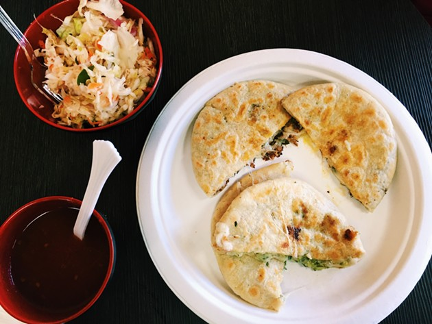 Pupusa plate: the pork on top, the zucchini and cheese on the bottom. - BETTY WANG