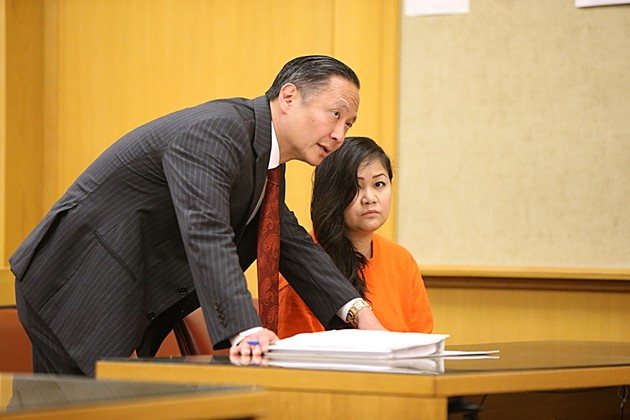 Lisa Heng with Jeff Adachi during a preliminary hearing - MIKE KOOZMIN