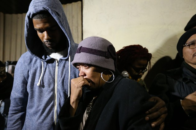 Jeff Stewart and Gwendolyn Woods mourn their cousin and son, Mario Woods - MIKE KOOZMIN/SF EXAMINER