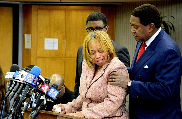 Gwendolyn Woods, Mario Woods's mother, is comforted by civil rights attorney John Burris, who filed a lawsuit on Friday, - CONNOR HUNT/SF EXAMINER