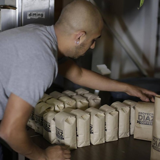 Co-owner of Proyecto Diaz Coffee, Fernando Diaz packages coffee beans from his grandfather's farm in Oaxaca. - PROYECTO DIAZ COFFEE