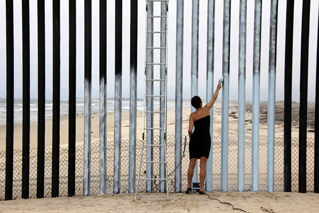 Borrando la Frontera (Erasing the Border, Performance Documentation at Tijuana/San Diego Border), 2011 - IMAGE TAKEN BY MARIA TERESA FERNANDEZ