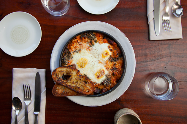 Baked eggs with white beans, spring veggies, and tarragon crusty bread, on the menu by Daniel Patterson at The Centurion Lounge at SFO - GETTY IMAGES FOR AMERICAN EXPRESS
